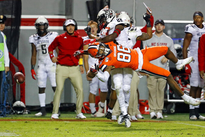 North Carolina State's Kishawn Miller (28) keeps Syracuse's Trishton Jackson (86) from catching a pass during the second half of an NCAA college football game in Raleigh, N.C., Thursday, Oct. 10, 2019. (AP Photo/Karl B DeBlaker)
