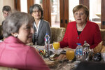 German Chancellor Angela Merkel, right, speaks with British Prime Minister Theresa May, left, during a meeting on the sidelines of an EU-Arab League summit at the Sharm El Sheikh convention center in Sharm El Sheikh, Egypt, Monday, Feb. 25, 2019. Leaders from European Union and Arab League countries met for a second day in the Egyptian resort city of Sharm el-Sheikh to discuss migration, security and business deals. (Olivier Weiken, Pool Photo via AP)