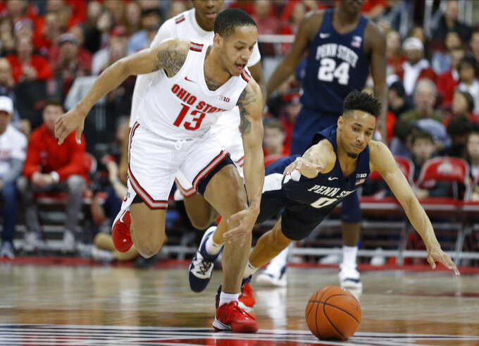 Ohio State's C.J. Walker, left, and Penn State's Myreon Jones chase a loose ball during the second half of an NCAA college basketball game Saturday, Dec. 7, 2019, in Columbus, Ohio. Ohio State beat Penn State 104-74. (AP Photo/Jay LaPrete)
