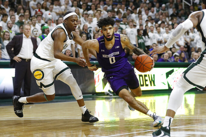 Northwestern guard Boo Buie (0) drives against Michigan State guard Cassius Winston, left, during the first half of an NCAA college basketball game, Wednesday, Jan. 29, 2020, in East Lansing, Mich. (AP Photo/Carlos Osorio)