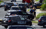FILE - In this June 28, 2018 file photo, police secure the scene of a shooting at the building housing The Capital Gazette newspaper in Annapolis, Md. A pool of 300 potential jurors will be in a Maryland court on Friday, Sept. 27, 2019, to answer questions about the mass shooting at the Capital Gazette newspaper that killed five people last year. (AP Photo/Susan Walsh, File)