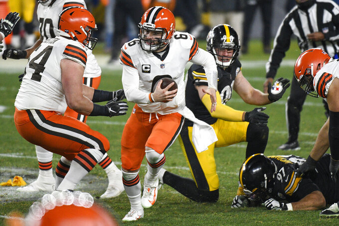 Cleveland Browns quarterback Baker Mayfield (6) moves out of the pocket during the first half of an NFL wild-card playoff football game against the Pittsburgh Steelers in Pittsburgh, Sunday, Jan. 10, 2021. (AP Photo/Don Wright)