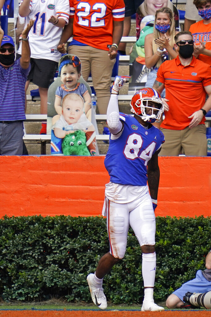 Florida tight end Kyle Pitts (84) celebrates his 56-yard touchdown off a pass from quarterback Kyle Trask during the first half of an NCAA college football game, Saturday, Nov. 28, 2020, in Gainesville, Fla. (AP Photo/John Raoux)