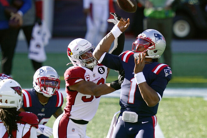 Arizona Cardinals linebacker Jordan Hicks, left, hits the arm of New England Patriots quarterback Cam Newton (1) causing an errant pass and an interception in the first half of an NFL football game, Sunday, Nov. 29, 2020, in Foxborough, Mass. (AP Photo/Elise Amendola)