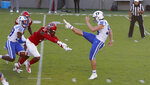 North Carolina State linebacker Vi Jones (31) blocks the punt by Duke punter Porter Wilson (98) during the first half of an NCAA college football game at Carter-Finley Stadium in Raleigh, N.C., Saturday, Oct. 17, 2020. (Ethan Hyman/The News & Observer via AP)