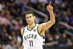Milwaukee Bucks center Brook Lopez gestures after he made a basket during the first half of the team's NBA basketball game against the Washington Wizards, Friday, Jan. 11, 2019, in Washington. (AP Photo/Nick Wass)