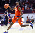 Clemson's Tevin Mack (13) moves the ball against Virginia Tech during the first half of an NCAA college basketball game Wednesday, March 4, 2020, in Blacksburg, Va. (Matt Gentry/The Roanoke Times via AP)