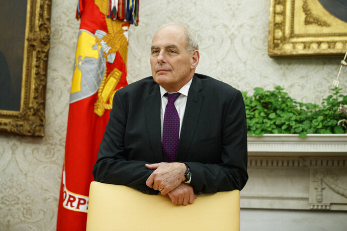 FILE - In this Nov. 16, 2018, file photo, White House Chief of Staff John Kelly watches as President Donald Trump speaks in the Oval Office of the White House in Washington. Trump's former chief of staff, Kelly, says he advised the president not to fill the job with someone who wouldn't be honest with him and provide a check on his impulses because he would end up being impeached. (AP Photo/Evan Vucci, File)