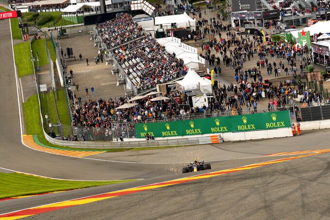 Red Bull driver Sergio Perez of Mexico steers his car during the second practice session prior to the Formula One Grand Prix at the Spa-Francorchamps racetrack in Spa, Belgium, Friday, Aug. 27, 2021. The Belgian Formula One Grand Prix will take place on Sunday. (AP Photo/Francisco Seco)