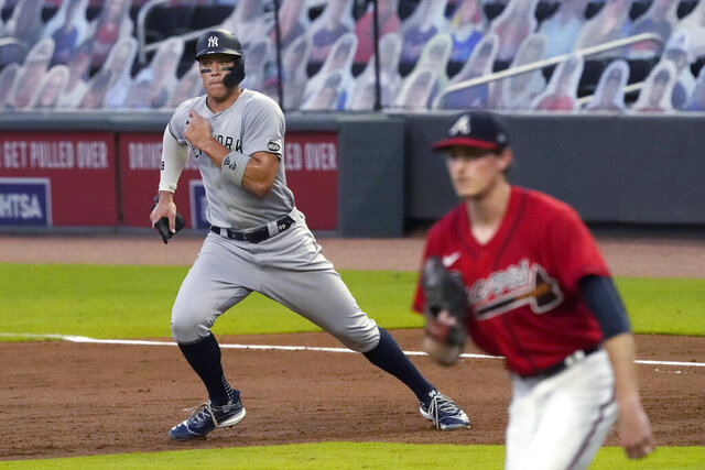 New York Yankees' Aaron Judge breaks for second on a ground ball by Luke Voit in the fourth inning of game two of baseball doubleheader Wednesday, Aug. 26, 2020, in Atlanta. Both were out on a double play on the at-bat. (AP Photo/John Bazemore)