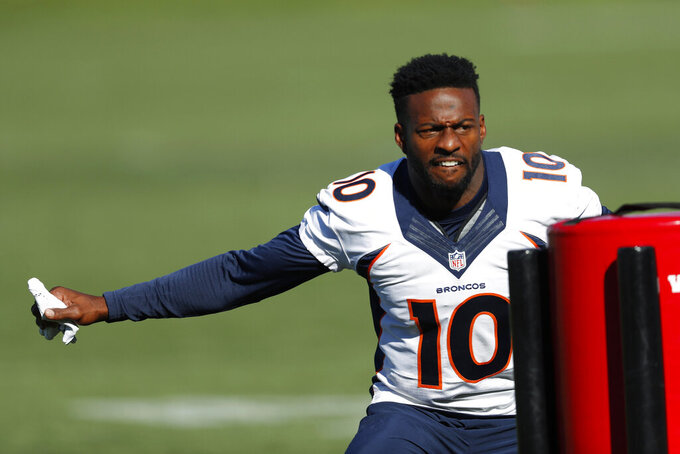 Denver Broncos wide receiver Emmanuel Sanders takes part in drills during an NFL football training camp session Tuesday, Aug. 6, 2019, in Englewood, Colo. (AP Photo/David Zalubowski)