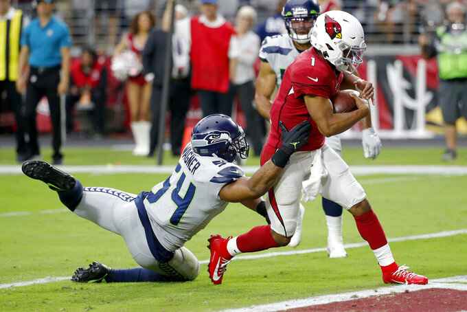 Arizona Cardinals quarterback Kyler Murray (1) runs in for a touchdown as Seattle Seahawks middle linebacker Bobby Wagner (54) defends during the second half of an NFL football game, Sunday, Sept. 29, 2019, in Glendale, Ariz. (AP Photo/Rick Scuteri)