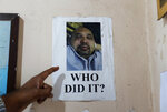 In this Nov. 6, 2019 photo, a portrait of Sri Lankan journalist Keith Noyahr who left the country following an alleged attack by a group of government soldiers is seen pasted on the wall of a human rights activist's office in Colombo, Sri Lanka. Forced to flee their country a decade ago to escape allegedly state-sponsored killer squads, Sri Lankan journalists living in exile doubt they'll be able to return home soon or see justice served to their tormentors _ whose alleged ringleader could come to power in this weekend's presidential election. Exiled journalists and media rights groups are expressing disappointment over the current government's failure in punishing the culprits responsible for crimes committed against media members. (AP Photo/Eranga Jayawardena)