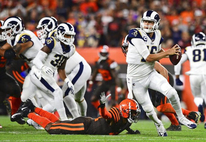 Los Angeles Rams quarterback Jared Goff (16) scrambles during the first half of an NFL football game against the Cleveland Browns, Sunday, Sept. 22, 2019, in Cleveland. (AP Photo/David Dermer)
