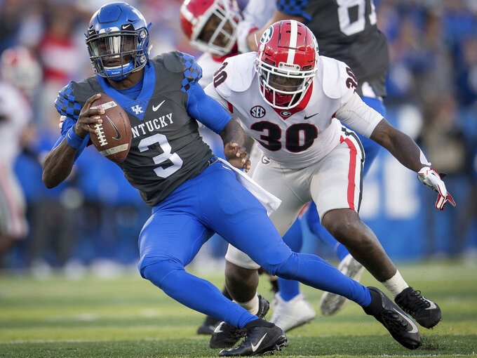 FILE - In this Saturday, Nov. 3, 2018, file photo, Georgia linebacker Tae Crowder (30) pressures Kentucky quarterback Terry Wilson (3) during the second half an NCAA college football game against in Lexington, Ky. Kentucky's biggest challenge may come Saturday when the Wildcats close their SEC schedule at Tennessee, where they have lost 16 straight and haven't won since 1984. (AP Photo/Bryan Woolston, File)