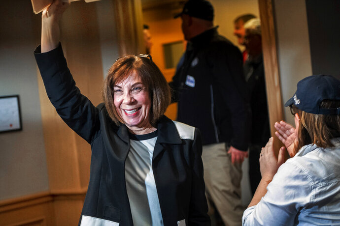 Democratic state Senator-elect for the Pennsylvania 37th District, Pam Iovino acknowledges cheers as she prepares to give her victory speech at her election night party, Tuesday, April 2, 2019, at Keystone Mountain Lakes Regional Council of Carpenters in Robinson Township outside Pittsburgh. (Michael M. Santiago/Pittsburgh Post-Gazette via AP)