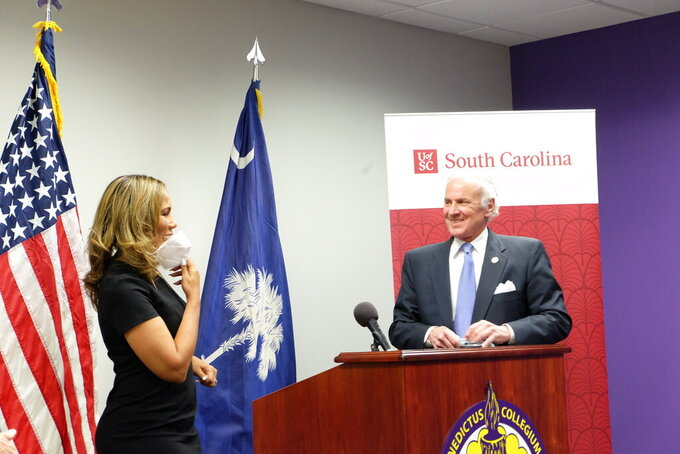 Benedict College President Roslyn Clark Artis talks to South Carolina Gov. Henry McMaster at a news conference in Columbia, S.C., on Tuesday, March 30, 2021, announcing eight new community computer labs. McMaster said that $6 million in coronavirus federal aid dollars would be spent on the labs, which will be located near broadband deserts across South Carolina. (AP Photo/Michelle Liu)