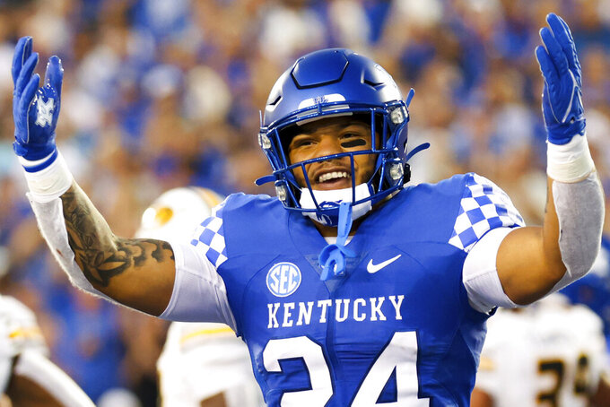 Kentucky running back Chris Rodriguez Jr. (24) celebrates scoring a touchdown during the first half of an NCAA college football game against Missouri in Lexington, Ky., Saturday, Sept. 11, 2021. (AP Photo/Michael Clubb)