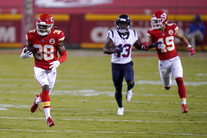 Kansas City Chiefs safety L'Jarius Sneed (38) runs back an intercepted pass against the Houston Texans in the second half of an NFL football game Thursday, Sept. 10, 2020, in Kansas City, Mo. (AP Photo/Jeff Roberson)