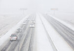 Vehicles driving in the snow on the southbound of Highway 6 Sunday, Jan. 10, 2021, in College Station, Texas. (Yi-Chin Lee/Houston Chronicle via AP)