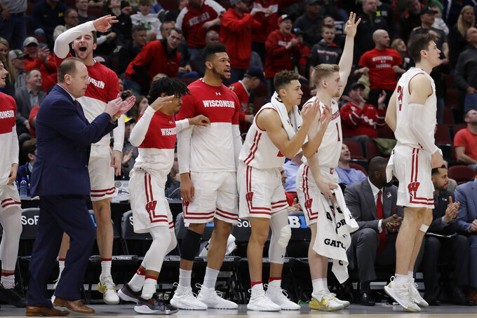 Wisconsin bench celebrate after D'Mitrik Trice scores a 3-point backet during the second half of an NCAA college basketball game against Nebraska in the quarterfinals of the Big Ten Conference tournament, Friday, March 15, 2019, in Chicago. Wisconsin won 66-62. (AP Photo/Nam Y. Huh)