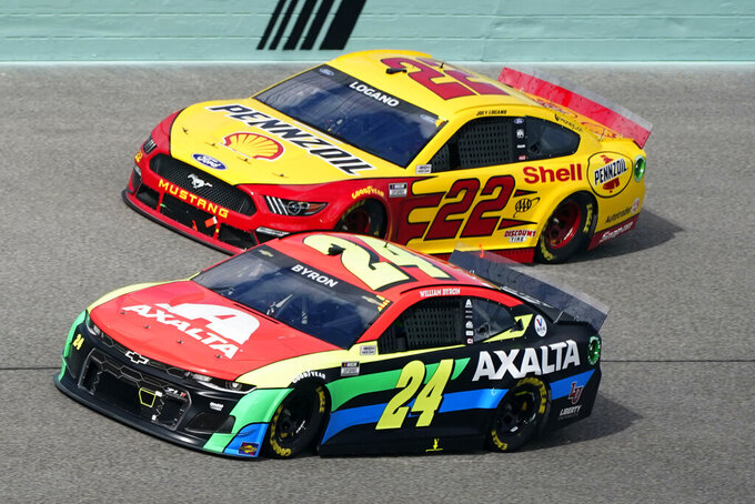 Joey Logano (22) and William Byron (24) battle for position during a NASCAR Cup Series auto race, Sunday, Feb. 28, 2021, in Homestead, Fla. (AP Photo/Wilfredo Lee)
