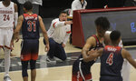 Arizona head coach Sean Miller, kneeling, yells instructions to his team in the first half of an NCAA College Basketball game against Washington State, Saturday, Jan. 2, 2021, in Pullman, Wash. (AP Photo/Dean Hare)