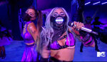 In this video grab issued Sunday, Aug. 30, 2020, by MTV, Ariana Grande, left, and Lady Gaga perform