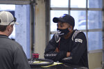 In this July 7, 2020 photo provided by NASCAR, Rajah Caruth listens in the garage during the Summer Shootout at Charlotte Motor Speedway in Concord, N.C. The sport has renewed optimism that its diversity program can field a bumper crop of promising prospects. Caruth might the one who can help lead the way. (NASCAR photo via (AP)
