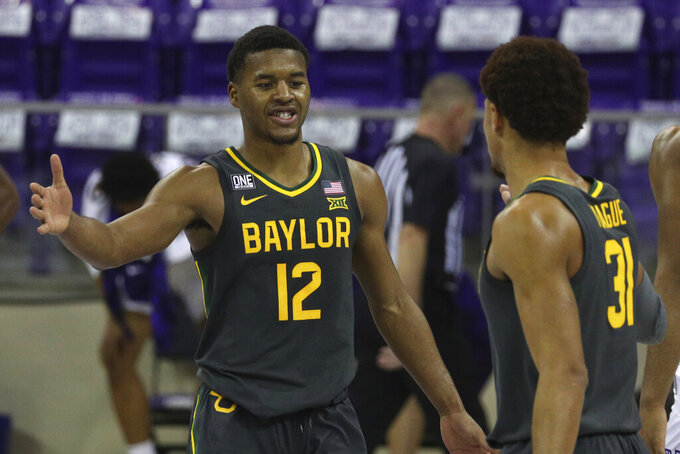 Baylor guard Jared Butler (12) celebrates the win over TCU with guard MaCio Teague (31) after an NCAA college basketball game, Saturday, Jan. 9, 2021, in Fort Worth, Texas. (AP Photo/ Richard W. Rodriguez)