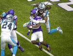 Carolina Panthers free safety Tre Boston (33) tackles Minnesota Vikings running back Dalvin Cook (33) in the first quarter of an NFL football game in Minneapolis, Sunday, Nov. 29, 2020. (Jerry HoltStar Tribune via AP)