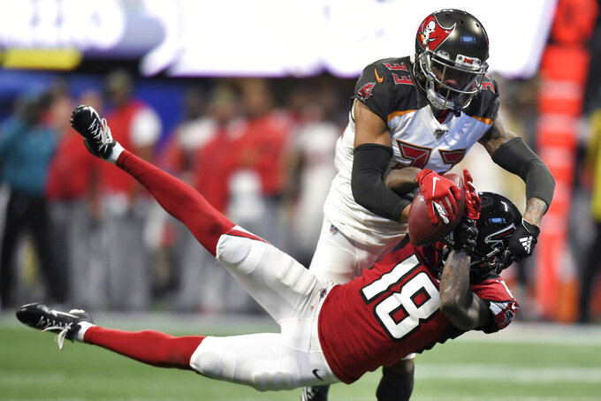 Tampa Bay Buccaneers cornerback Carlton Davis (33) intercepts the ball against Atlanta Falcons wide receiver Calvin Ridley (18) during the second half of an NFL football game, Sunday, Nov. 24, 2019, in Atlanta. (AP Photo/Danny Karnik)