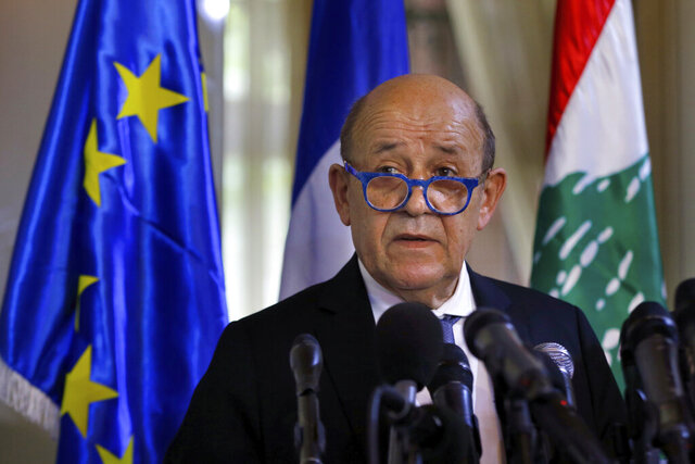 French Foreign Minister Jean-Yves Le Drian, and his Lebanese counterpart Nassif Hitti, hold a news conference following their meeting at the Lebanese foreign ministry in Beirut, Lebanon, Thursday, July. 23, 2020. Le Drian met with Lebanon's president Thursday at the start of his two-day visit to the Mediterranean country that is witnessing the worst economic crisis of its modern history. (AP Photo/Bilal Hussein)