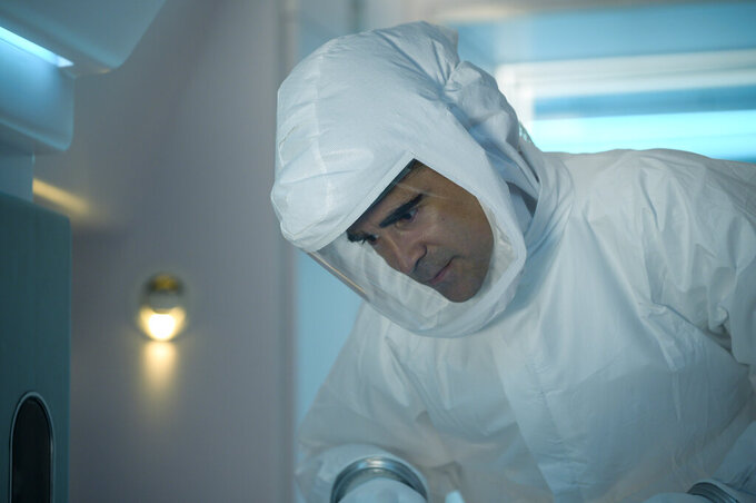 "This image released by Lionsgate shows Colin Farrell in a scene from ""Voyagers."" (Vlad Cioplea/Lionsgate via AP)"