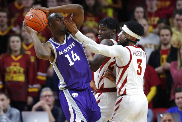 Iowa State guard Tre Jackson, right, defends as Kansas State forward Makol Mawien, left, looks to pass during the second half of an NCAA college basketball game, Saturday, Feb. 8, 2020, in Ames, Iowa. (AP Photo/Matthew Putney)