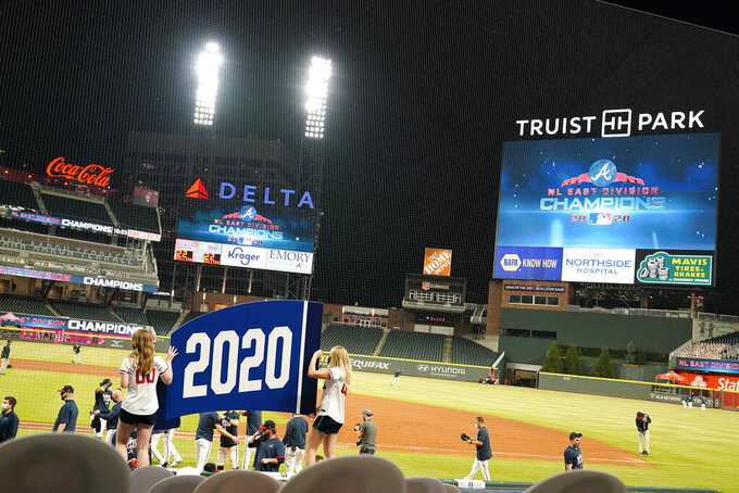 The Atlanta Braves celebrate after a baseball game to clinch the NL East title against the Miami Marlins on Tuesday, Sept. 22, 2020, in Atlanta. (AP Photo/Brynn Anderson)