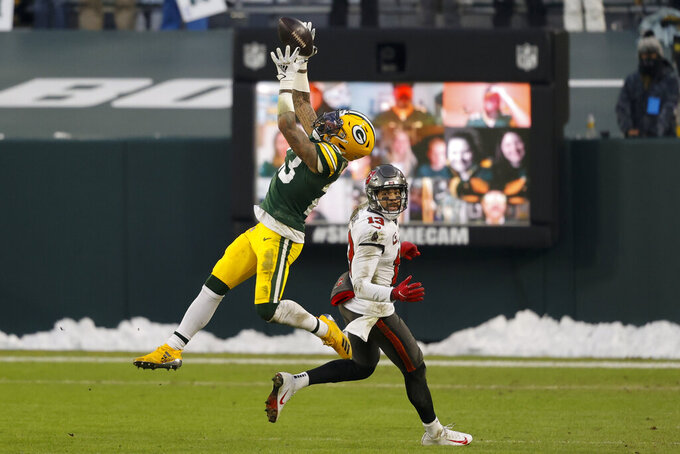Green Bay Packers' Jaire Alexander (23) celebrates after intercepting a pass intended for Tampa Bay Buccaneers' Mike Evans during the second half of the NFC championship NFL football game in Green Bay, Wis., Sunday, Jan. 24, 2021. (AP Photo/Jeffrey Phelps)