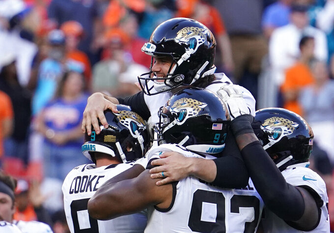 Jacksonville Jaguars kicker Josh Lambo, above, celebrates with teammates after making a game-winning field goal during the second half of an NFL football game against the Denver Broncos, Sunday, Sept. 29, 2019, in Denver. (AP Photo/Jack Dempsey)