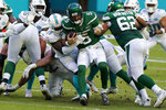 New York Jets quarterback Joe Flacco (5) is sacked by Miami Dolphins linebacker Sam Eguavoen (49), during the first half of an NFL football game, Sunday, Oct. 18, 2020, in Miami Gardens, Fla. (AP Photo/Wilfredo Lee)