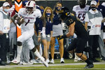 South Alabama quarterback Desmond Trotter (1) runs away from Southern Mississippi linebacker Hayes Maples (32) during the first half of an NCAA college football game in Hattiesburg, Miss., Thursday, Sept. 3, 2020. (AP Photo/Rogelio V. Solis)