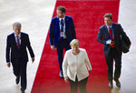 German Chancellor Angela Merkel walks on the red carpet as she arrives for an EU summit in Brussels, Thursday, June 20, 2019. European Union leaders are meeting for a two-day summit to begin the process of finalizing candidates for the bloc's top jobs. (AP Photo/Olivier Matthys)