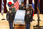 Honor guards of South Korea and the United Nations Command (UNC) carry a box containing the remains of an unidentified allied soldier, presumably American, killed during the 1950-53 Korean War, at a mutual repatriation ceremony at Seoul National Cemetery in Seoul, South Korea, Friday, July 13, 2018. The United States and South Korea held the ceremony to return home the remains of him and a South Korean soldier. (Jeon Heon-kyun/Pool Photo via AP)