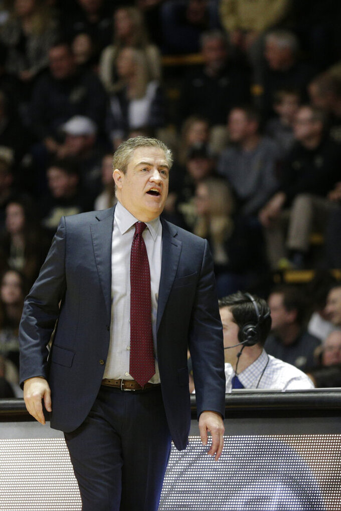 Central Michigan head coach Keno Davis reacts during the first half of an NCAA college basketball game in West Lafayette, Ind., Saturday, Dec. 28, 2019. (Nikos Frazier/Journal & Courier via AP)