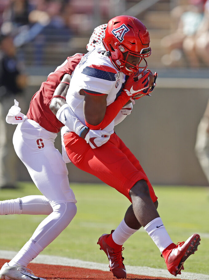 Arizona's Jalen Johnson, right, scores a touchdown against Stanford in the first half of an NCAA college football game Saturday, Oct. 26, 2019, in Stanford, Calif. (AP Photo/Ben Margot)