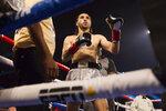 Nico Ali Walsh prepares for his middleweight boxing bout against Jordan Weeks on Saturday, Aug. 14, 2021, near Tulsa, Okla. (Brett Rojo/Tulsa World via AP)