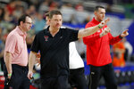 Texas Tech head coach Chris Beard directs his team during a practice session for the semifinals of the Final Four NCAA college basketball tournament, Friday, April 5, 2019, in Minneapolis. (AP Photo/Charlie Neibergall)