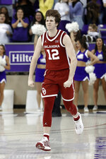 Oklahoma guard Austin Reaves (12) celebrates sinking a 3-point basket in the final seconds of the second half of an NCAA college basketball game against TCU in Fort Worth, Texas, Saturday, March 7, 2020. The bucket helped Oklahoma to the 78-76 win. (AP Photo/Tony Gutierrez)