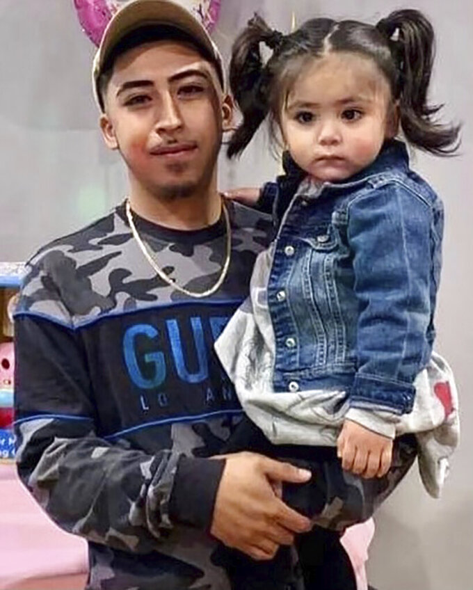 This undated family photo provided by Todd Pugh and Tania Dimitrova, Attorneys for the Alvarez family, shows Anthony Alvarez with his daughter in Chicago. Alvarez was shot and killed after a foot chase with Chicago Police on March 31, 2021. (Courtesy Giselle Higuera and the Alvarez family via AP)