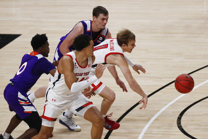 Texas Tech guard Mac McClung struggles for control of the ball during the first half of an NCAA college basketball game against Northwestern State, Wednesday Nov. 25, 2020, in Lubbock, Texas. (AP Photo/Mark Rogers)