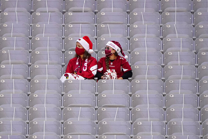 Arizona Cardinals fans watch during the first half of an NFL football game against the Philadelphia Eagles, Sunday, Dec. 20, 2020, in Glendale, Ariz. (AP Photo/Rick Scuteri)